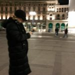 LV lookining at her phone in, Piazza Duomo, Milan