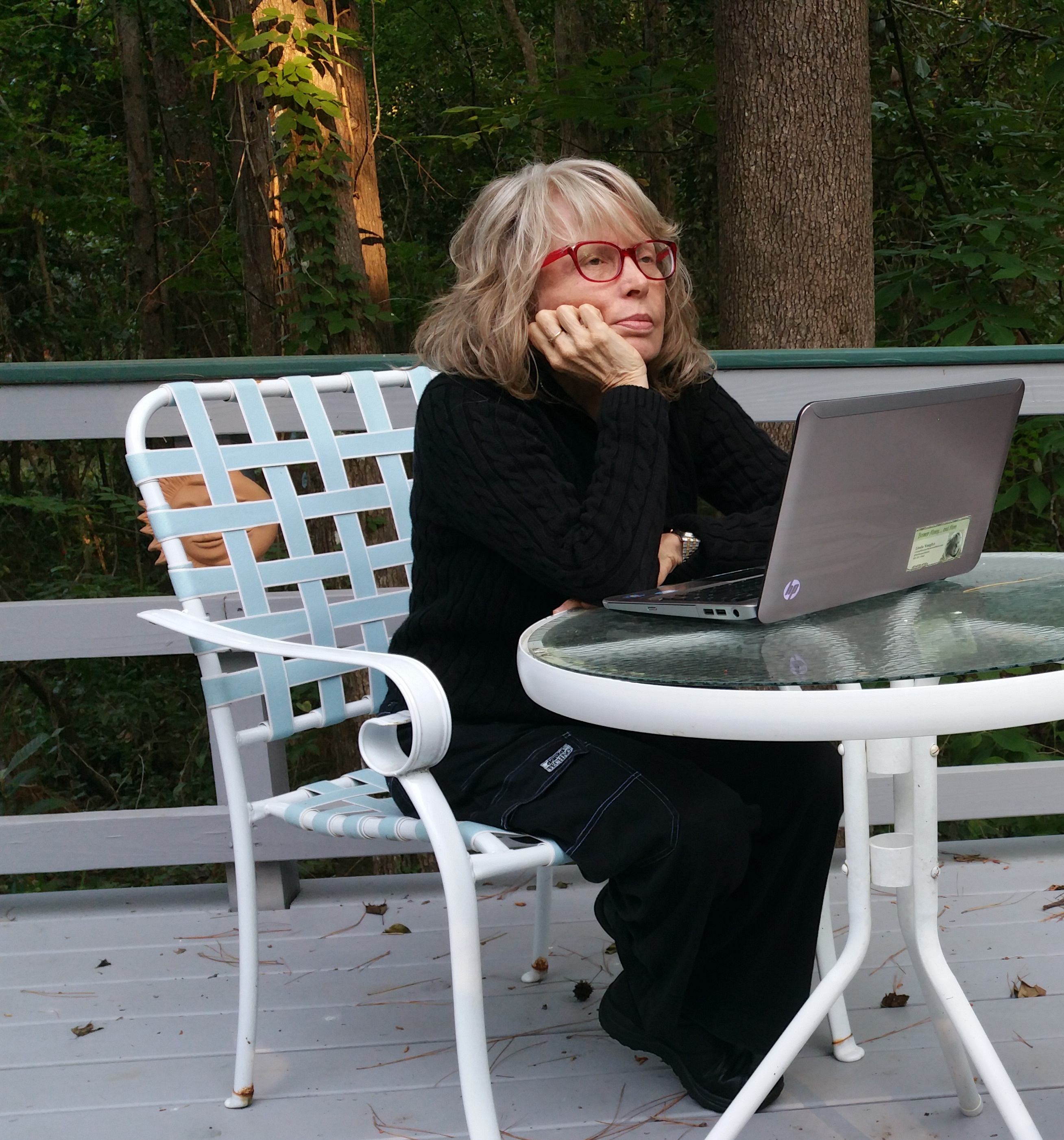 """LV sitting at outdoor table, thinking """"I should have reflected more on my upcoming retirement.."""""""