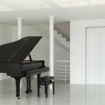 black grand piano in white room
