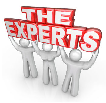 the word experts in red stencil