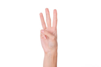 woman hand holding three fingers up