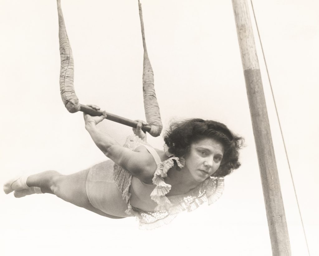 Vintage black and white photo of woman on trapeze