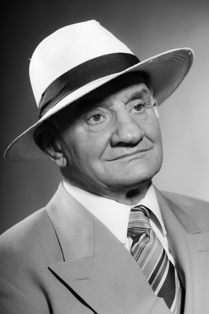 Vintage melancholy photo of man in hat wishing he hadn't used the retirement replacement ratio.