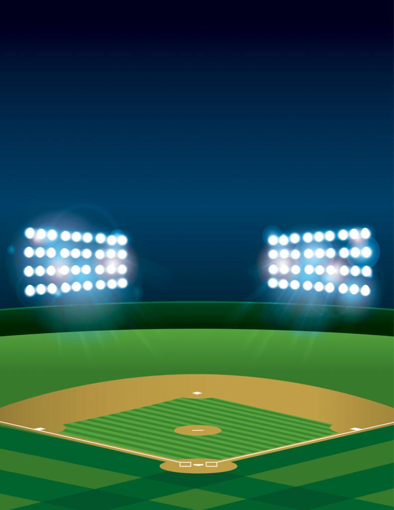 Empty baseball field at night with lights still on.