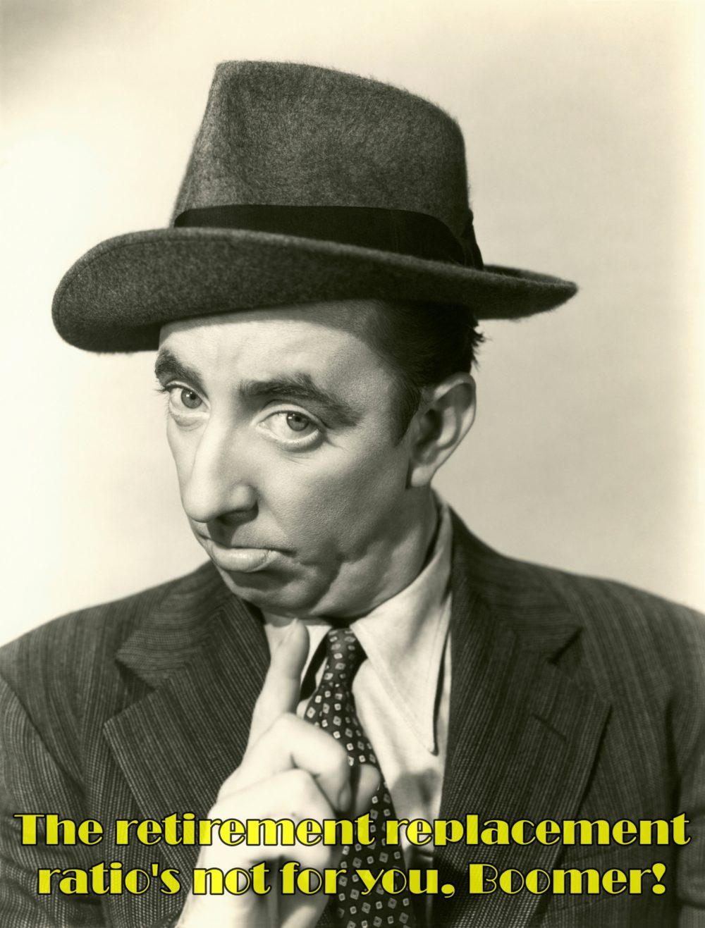Retro black and white photo of man in suit and hat pointing his finger in warning to viewer not to rely on the retirement replacement ratio.