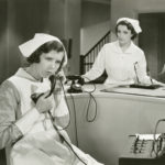 Vintage photo of nurse on phone trying to get Medicare to pay a patient's health care expenses.