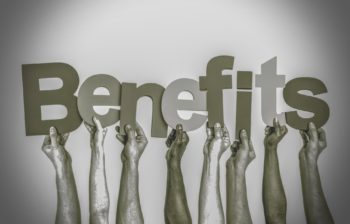 hands holding individual letters that spell out the word benefits