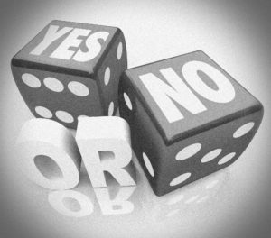 """black and white photo of dice who's tops say """"yes"""" or """"no"""""""