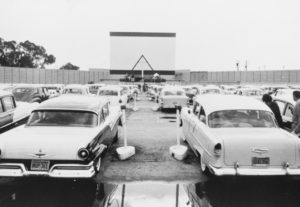 Vintage black and white photo of cars at the drive-in