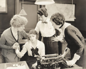 Black and white retro photo of three women comforting a typist about sequence of returns risk