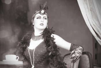 Black and white retro photo ofimperious showgirl announcing she's ready for her annuity free withdrawal.