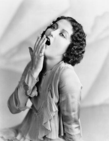 B&W vintage photo of woman yawning because she's too bored to lose her bad annuity.