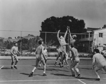 Black and white retro photo of young men playing basketball symbolizing how people shouldn't take their money cues from those playing a different game than they are.