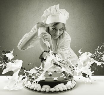Female chef doing sloppy job decorating cake, claiming the customer will nonetheless love it--just like a sales agent might tell folks they'll love the shortcomiings of equity indexed annuities.