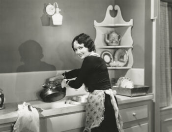 Retro black and white photo of a woman in an apron preparing food, claiming she'll sweeten the pie of a fixed annuity.