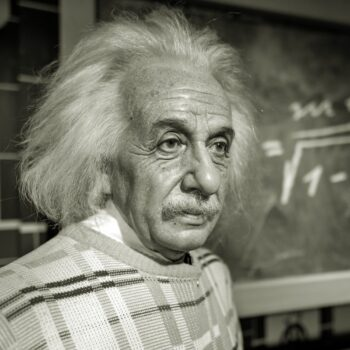 Photo of Albert Einstein lamenting that he could have made something of himself if he'd just understood compound interest.