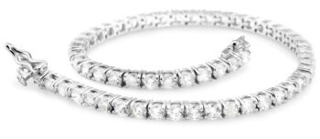 Photo of tennis bracelet that had a price tag of $2K, but with compound interest, ended up costing me $60K